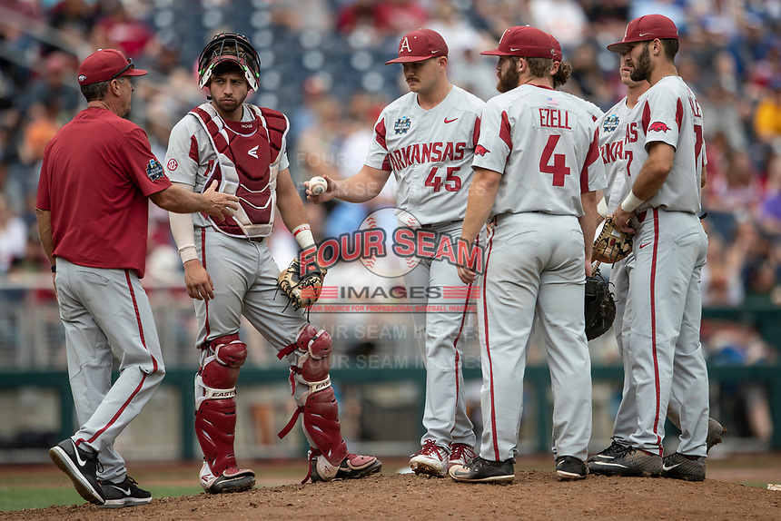 Arkansas Razorbacks pitcher Kevin Kopps (45) leaves the mound after being removed from Game 5 of the NCAA College World Series against the Texas Tech Red Raiders on June 17, 2019 at TD Ameritrade Park in Omaha, Nebraska. Texas Tech defeated Arkansas 5-4. (Andrew Woolley/Four Seam Images)