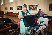 Sorting donated clothing at Norwood foodbank.  The foodbank operates under the umbrella of the Trussell Trust, a Christian charity.