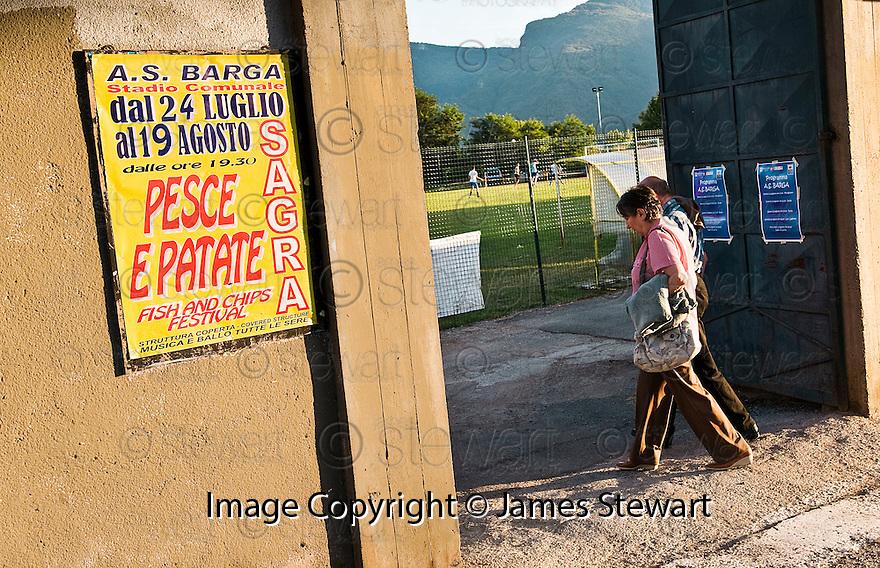 "SAGRA DEL ""PESCE E PATATE"" 2011, BARGA, ITALY<br /> <br /> LOCALS ARRIVES AT THE STADIO COMUNALE ""JOHNNY MOSCARDINI"", HOME OF A.S. BARGA AND THE LOCATION OF THE SAGRA DEL ""PESCE E PATATE"" 2011"