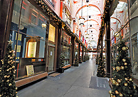 The Royal Arcade in Old Bond Street, is an historic Victorian era shopping arcade - the oldest in London.  Completed in 1880 and is Grade II listed. Decorated for Christmas despite it's shops being currently closed due to the Covid-19 Lockdown. London November 20th 2020<br /> <br /> Photo by Keith Mayhew