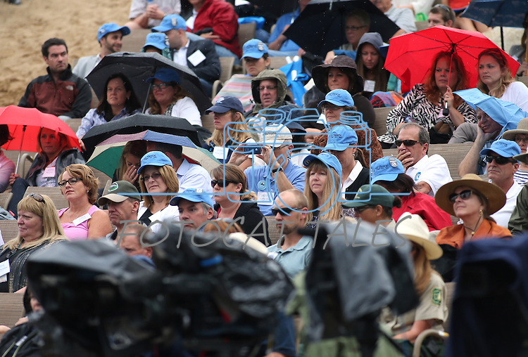 Hundreds of people attended the 17th annual Lake Tahoe Summit conference at Sand Harbor, near Incline Village, Nev., on Monday, Aug. 19, 2013. The event brings representatives together from agencies around Nevada and California to protect Lake Tahoe. A brief shower moved through during the event.<br />