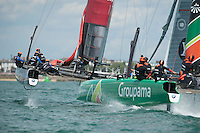 25 July 2015: Emirates Team New Zealand lead Groupama Team France round the windward mark during the America's Cup first round racing off Portsmouth, England (Photo by Rob Munro)
