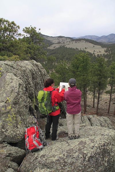 Two women navigating with map and compass. Front Range, Colorado.