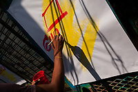 "A Colombian sign painter's hand is seen writing letters with a brush on a music party poster in the sign painting workshop in Cartagena, Colombia, 18 April 2018. Hidden in the dark, narrow alleys of Bazurto market, a group of dozen young men gathered around José Corredor (""Runner""), the master painter, produce every day hundreds of hand-painted posters. Although the vast majority of the production is designed for a cheap visual promotion of popular Champeta music parties, held every weekend around the city, Runner and his apprentices also create other graphic design artworks, based on brush lettering technique. Using simple brushes and bright paints, the artisanal workshop keeps the traditional sign painting art alive."
