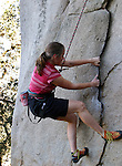 Bouldering is a style of rock climbing undertaken without a rope and normally limited to very short climbs so that a fall will not result in serious injury. It is typically practiced on large boulders or artificial man-made boulders. However, it may also be practiced at the base of larger rock faces and climbers tether themselves. To reduce the risk of injury from a fall, climbers rarely go higher than 3-5 meters above the ground (anything over 7 meters is generally considered to be free-soloing, although such climbs might also be termed high-ball bouldering problems). For further protection, climbers typically put a bouldering mat (crash pad) on the ground to break their fall. Lastly, climbers often have one or more spotters, who work to direct the climber's body toward the crash pad during a fall, while protecting the climber's head from hazards...