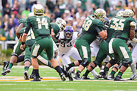 TCU defensive tackle Suleiman Masumbuko (93) pushes back by Baylor offensive line as quarterback Bryce Petty (14) rushes for a first down during an NCAA football game, Saturday, October 11, 2014 in Waco, Tex. Baylor defeated TCU 61-58 to remain undefeated in BIG 12 conference. (Mo Khursheed/TFV Media via AP Images)