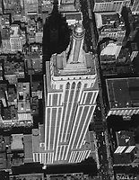 "Undated aerial photo of the<br /> Empire State Building in New York City,USA.<br /> <br /> The Empire State Building is a 102-story[c] Art Deco skyscraper in Midtown Manhattan, New York City. It was designed by Shreve, Lamb & Harmon and built from 1930 to 1931. Its name is derived from ""Empire State"", the nickname of the state of New York. The building has a roof height of 1,250 feet (380 m) and stands a total of 1,454 feet (443.2 m) tall, including its antenna"