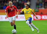 Marta (r) of team Brazil and Marita Skammelsrud Lund of team Norway during the FIFA Women's World Cup at the FIFA Stadium in Wolfsburg, Germany on July 3rd, 2011.