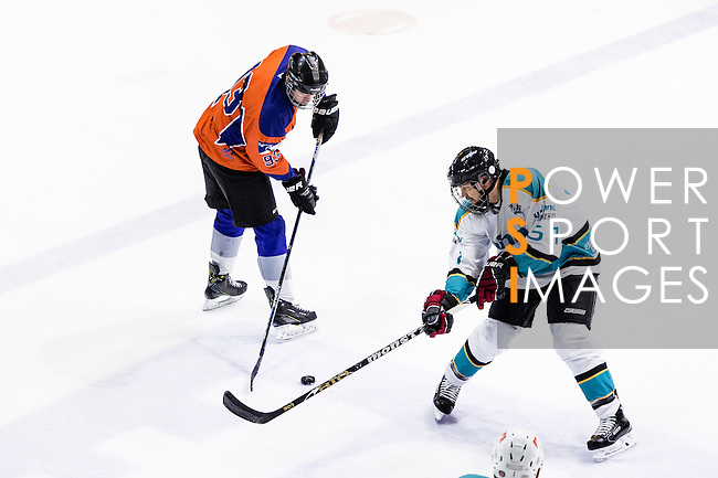 Medical Kings Skater Greg Gough (r) fights for the control of the puck with Principal Forward Connor Daly (l) during the Principal Standard League match between Principal vs Winner Medical Kings at the Mega Ice on 03 January 2017 in Hong Kong, China. Photo by Marcio Rodrigo Machado / Power Sport Images