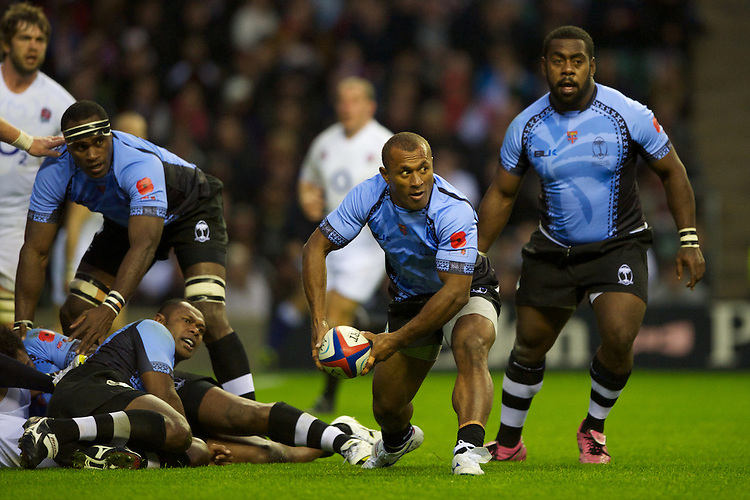 Kelemedi Bola of the Flying Fijians passes during the QBE International between England and Fiji at Twickenham on Saturday 10th November 2012 (Photo by Rob Munro)