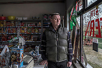 Fikret Bacic in the shop he runs from  his home. 29 members of his extended family were taken by Bosnian Serb forces and killed in July 1992. He is still searching for the remains of most of them.