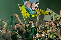 Portland, Oregon - Wednesday September 25, 2019: The Timbers Army celebrates going up 1-0 during a regular season game between Portland Timbers and New England Revolution at Providence Park on September 25, 2019 in Portland, Oregon.