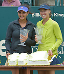 Martina Hingis (SUI) (yellow jacket),  with partner Sania Mirza (IND), win in the finals at the Family Circle Cup in Charleston, South Carolina on April 12, 2015.  Mirza became the number one doubles player in the world as a result of the win.