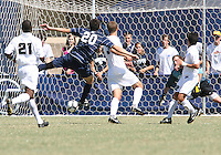 Andy Riemer #20 of Georgetown University shoots and scores against Avery Steinlage #0 of Michigan State during an NCAA match at North Kehoe Field, Georgetown University on September 5 2010 in Washington D.C. Georgetown won 4-0.