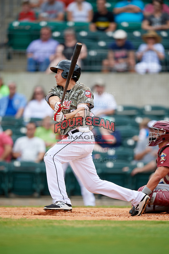 Arkansas Travelers third baseman Seth Mejias-Brean (28) follows through on a swing during a game against the Frisco RoughRiders on May 28, 2017 at Dickey-Stephens Park in Little Rock, Arkansas.  Arkansas defeated Frisco 17-3.  (Mike Janes/Four Seam Images)
