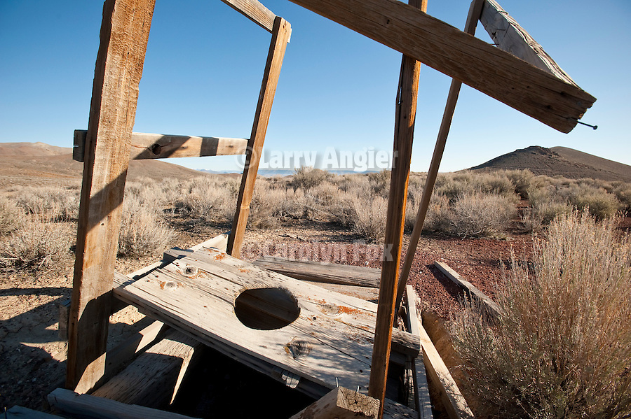 Outhouse and hole falling apart in the landscape at the Baldwin Mine, Jackson Range, Nev.  ..