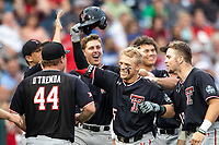 Texas Tech Red Raiders second baseman Brian Klein (5) is greeted by his teammates after hitting a home run in the sixth inning of Game 9 of the NCAA College World Series against the Florida State Seminoles on June 19, 2019 at TD Ameritrade Park in Omaha, Nebraska. Texas Tech defeated Florida State State 4-1. (Andrew Woolley/Four Seam Images)