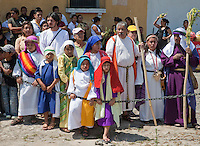 Participants in the Palm Sunday Re-enactment of events in the life of Jesus, by the group called Luna LLena (Full Moon), a group of volunteers in Antigua, Guatemala.