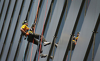 Kelly.Jordan@jacksonville.com--052011--**[HAS A VIDEO AND PHOTO GALLERY]**Jon Lessig, of Fleming Island, is reflected in a window as he makes his descent rappelling 450 feet to the ground during the Over The Edge event to benefit The Boy Scouts of America North Florida Council. Fifty eight people will rappel down the 30-story side of the AT&T Tower at 301 W. Bay St., one of the tallest buildings in downtown. Participants had to raise a minimum of $1,000 in pledges to be able to take on the challenge.(The Florida Times-Union, Kelly Jordan)