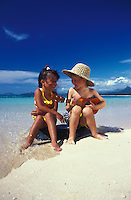 Boy in beach hat with ukulele serenades his friend