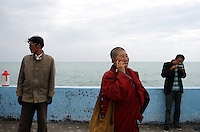 Local Tibetans at Qinghai Lake. Qinghai Lake, China's largest inland body of water lies at over 3000m on the Qinghai-Tibetan Plateau. The lake has been shrinking in recent decades, as a result of increased water-usage for local agriculture. Qinghai Province. China. 2010