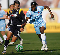 Han Duan (9) of the Los Angeles Sol and Anita Asante (5) of Sky Blue FC. The Los Angeles Sol defeated Sky Blue FC 2-0 during a Women's Professional Soccer match at TD Bank Ballpark in Bridgewater, NJ, on April 5, 2009. Photo by Howard C. Smith/isiphotos.com