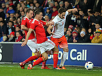 Daley Blind of Netherlands (R) is challenged by \James Chester of Wales  (C) during the Wales v Netherlands  International Friendly, at Cardiff City Stadium, Cardiff, Wales, United Kingdom, 13 November 2015.