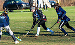 LITCHFIELD, CT-111820JS14—Wamogo's Grace Farrell  (6) fires a shot on goal past Shepaug's Imre Mancini (12)  during their field hockey game Wednesday at Wamogo High School. <br />  Jim Shannon Republican-American