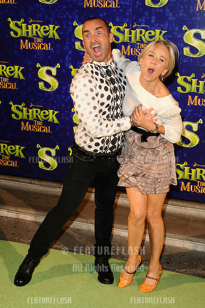 """Louie Spence and actress, Lisa maxwell arrives for the 1st night party of """"Shrek The Musical"""" at Somerset House, London. 14/06/2011  Picture by: Steve Vas / Featureflash"""