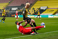 Uche Ikpeazu of Wycombe Wanderers is judged to have fouled Will Hughes of Watford during the Sky Bet Championship behind closed doors match between Watford and Wycombe Wanderers at Vicarage Road, Watford, England on 3 March 2021. Photo by David Horn.