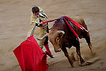 """Spanish matador Julian Lopez """"El Juli"""" performs a pass with capote to a Torrehandilla´s bull during the last corrida of the San Fermin Festival, on July 14, 2012, in the Northern Spanish city of Pamplona. (c) Pedro ARMESTRE"""