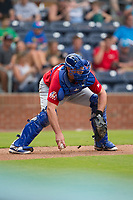 Buffalo Bisons catcher Mike Ohlman (14) picks up the baseball after a wild pitch during the game against the Durham Bulls at Durham Bulls Athletic Park on April 30, 2017 in Durham, North Carolina.  The Bisons defeated the Bulls 6-1.  (Brian Westerholt/Four Seam Images)