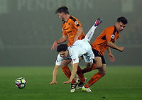Pictured: Daniel James of Swansea City (C) is brought down by Wolverhampton Wanderers players Monday 13 March 2017<br /> Re: Premier League 2, Swansea City U23 v Wolverhampton Wanderers FC at the Liberty Stadium, Swansea, UK