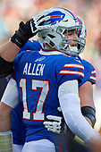 Buffalo Bills quarterback Josh Allen (17) celebrates with Wyatt Teller (75) after a touchdown during an NFL football game against the New York Jets, Sunday, December 9, 2018, in Orchard Park, N.Y.  (Mike Janes Photography)