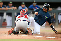 Catcher Juan Uriarte (17) of the Columbia Fireflies is safe at home as catcher Logan Brown of the Rome Braves tries to grab the ball in a game on Tuesday, June 4, 2019, at Segra Park in Columbia, South Carolina. Columbia won, 3-2. (Tom Priddy/Four Seam Images)