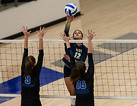 Ana Bastos (12) of Bentonville West hits the ball over Ellea McLeod (9) and Loryn Elkins (16) of Rogers at Rogers High School, Rogers, AR, on Thursday, September 9, 2021 / Special to NWADG David Beach