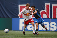 New York Red Bulls midfielder Chris Leitch (33) battles San Jose Earthquakes midfielder Ivan Guerrero (23) for the ball during a Major League Soccer match at Giants Stadium in East Rutherford, NJ, on April 27, 2008.