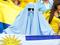 A Uruguay fan in a bed sheet with big teeth - is it Luis Suarez