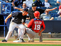 5 March 2011: Washington Nationals' infielder Brian Bixler slides in ahead of the tag by Bradley Suttle during a Spring Training game against the New York Yankees at George M. Steinbrenner Field in Tampa, Florida. The Nationals defeated the Yankees 10-8 in Grapefruit League action. Mandatory Credit: Ed Wolfstein Photo