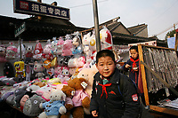 CHINA. Shanghai. School children in a market in the old town. Shanghai is a sprawling metropolis or 15 million people situated in south-east China. It is regarded as the country's showcase in development and modernity in modern China. This rapid development and modernization, never seen before on such a scale has however spawned countless environmental and social problems. 2008