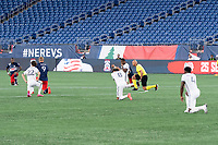 FOXBOROUGH, UNITED STATES - AUGUST 20: Players and officials kneel for a moment of silence after the first whistle during a game between Philadelphia Union and New England Revolution at Gilette on August 20, 2020 in Foxborough, Massachusetts.