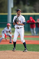 Virginia Cavaliers relief pitcher Alec Bettinger (13) looks to his catcher for the sign against the Hartford Hawks at The Ripken Experience on February 27, 2015 in Myrtle Beach, South Carolina.  The Cavaliers defeated the Hawks 5-1.  (Brian Westerholt/Four Seam Images)
