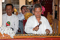 Myanmar, Burma.  Mandalay.  Mahamuni Buddhist Temple.  Musicians Playing Xylophone, Gong, and an Oboe-like Wind Instrument Called a Hne.