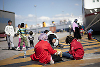 Pictured: Migrants are resting on the ground Thursday 03 March 2016<br /> Re: Migrants have been gathering at the port of Piraeus, near Athens, Greece