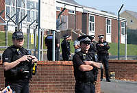 Pictured: Police officers outside the Penally Army Centre in west Wales, UK.<br /> Re: There was no consultation with local communities or the Welsh Government over possible plans to house about 250 asylum seekers it has been claimed, at a military base, at Penally, west Wales, UK.<br /> The Penally Army centre in Pembrokeshire is one of several sites being considered by the Home Office.<br /> But the Welsh Government said on social media it had not been approached.