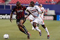 The MetroStars' Eddie Pope keeps the ball away from the Fire's Damani Ralph. The Chicago Fire were defeated by the NY/NJ MetroStars 2-1 at Giant's Stadium, East Rutherford, NJ, on July 24, 2004.