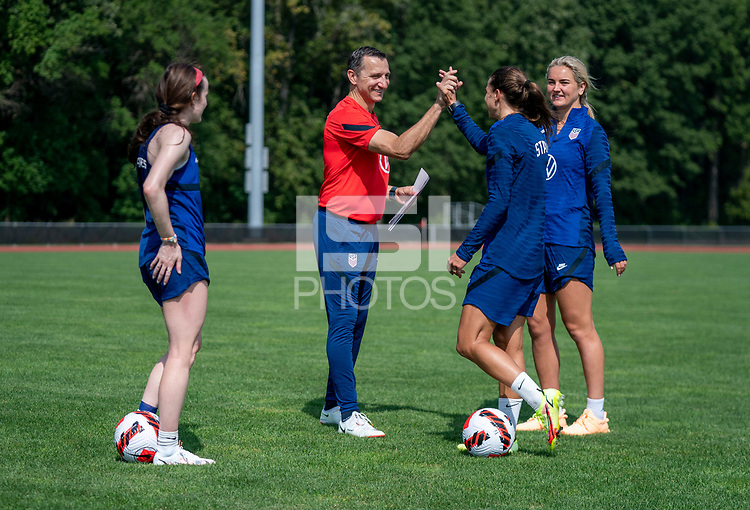 CLEVELAND, OH - SEPTEMBER 14: Vlatko Andonovski of the United States high fives Tobin after during a training session at the training fields on September 14, 2021 in Cleveland, Ohio.