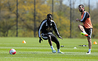 (L-R) Bafetimbi Gomis and Jordi Amat during the Swansea City FC training at Fairwood, Swansea, Wales, UK on Wednesday 04 May 2016
