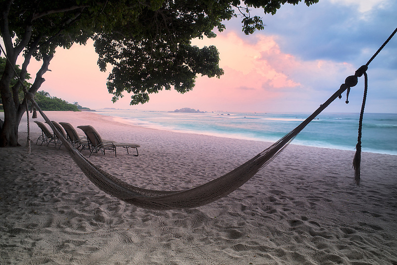 Sunset on beach with hammock at Punta Mita, Mexico.