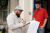Ziaur Rahman, Community Development Officer, Queens Park, does a door-to-door housing conditions survey in Bravington Road.